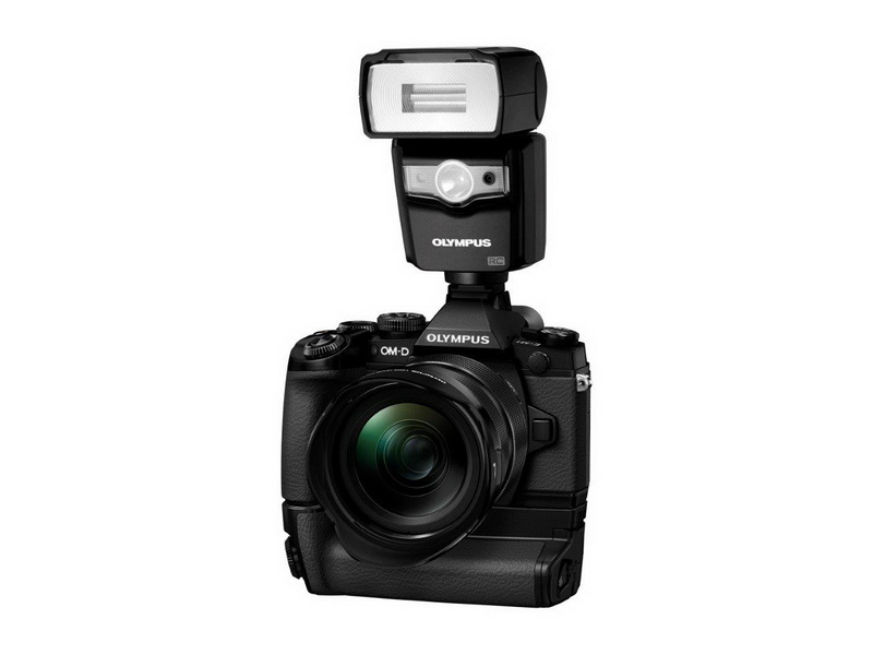 Olmpus OM-D E-M1 front with grip and external flash